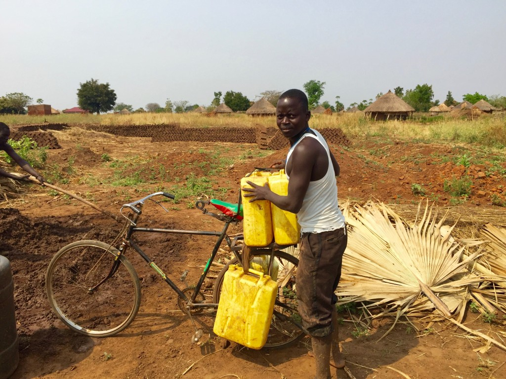 This was probably his tenth trip to the borehole to get water to for the brick making.