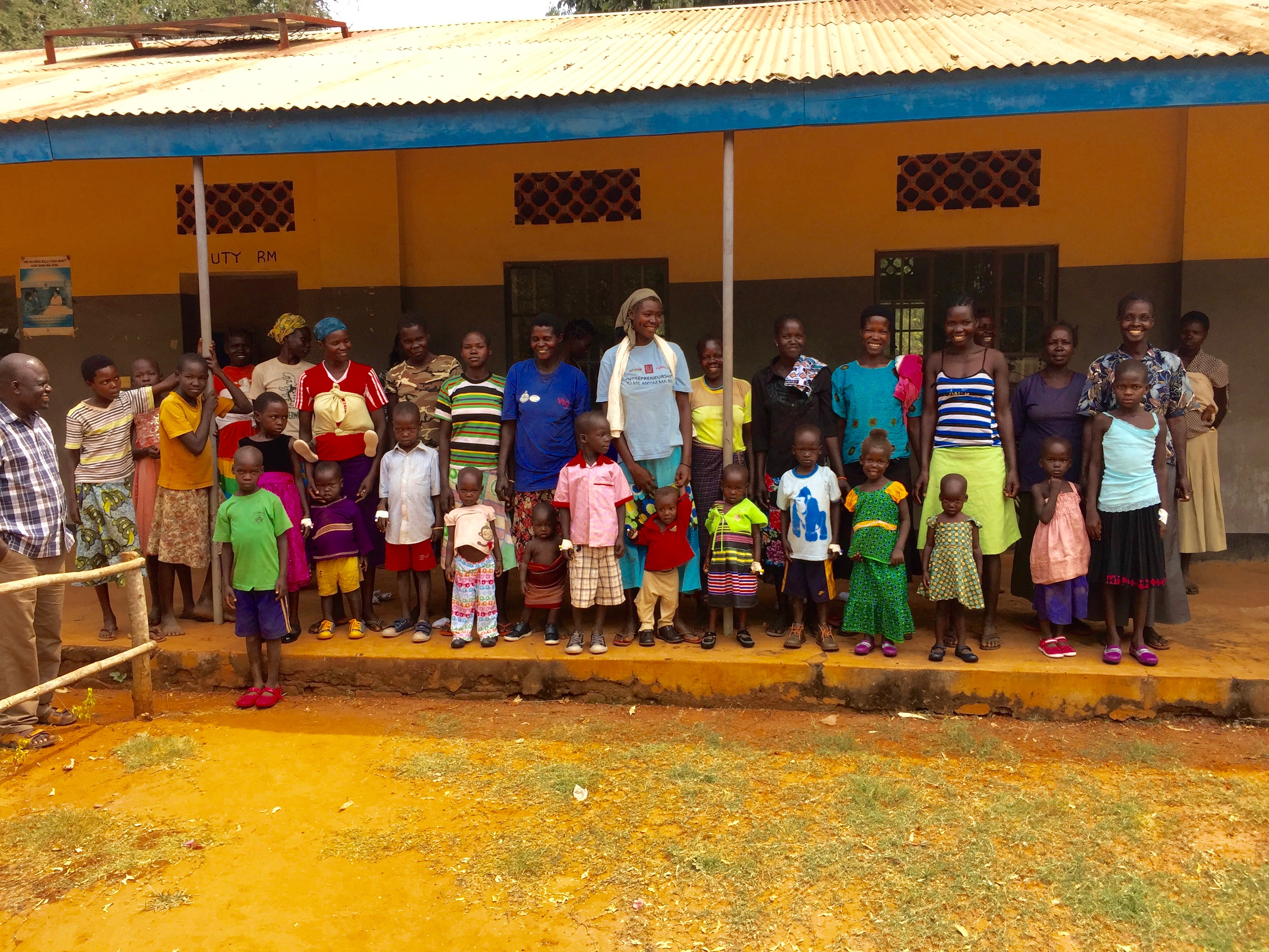 Some of the mothers and children line up for a photo with their new Umi shoes.