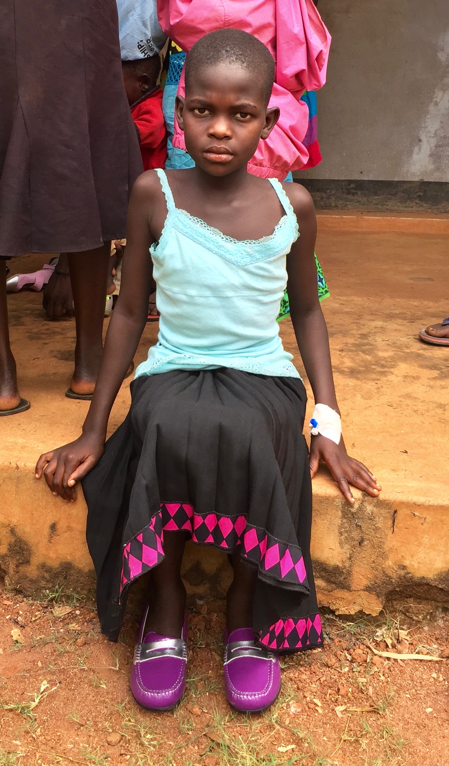 A very grateful young lady at the health center with her very pretty Umi shoes thanks to Tom Florsheim.