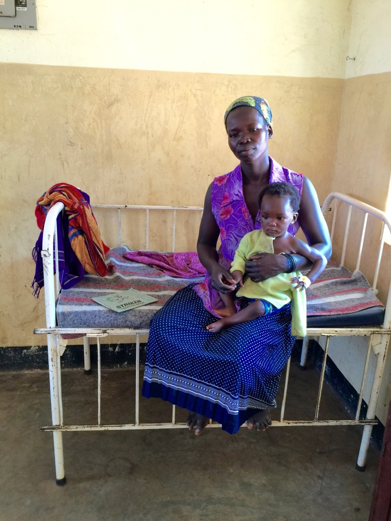 Mother with her small child in the Children's ward.
